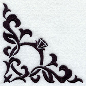 A damask machine embroidery corner design with a diamond ring.