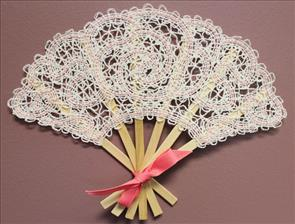 A Battenburg lace decorative hand fan with a machine design rose design.
