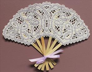 A Battenburg lace machine embroidery fan design with a butterfly design.