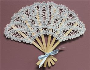 A Battenburg lace machine embroidery fan design with a fancy flourish design.