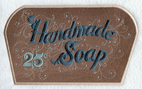 "A Victorian-era bathroom sign that says ""Handmade Soap 25 Cents."""