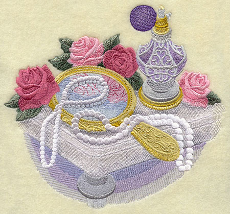 A Victorian dressing table machine embroidery design with perfume spritzer, mirror, roses, and pearls.
