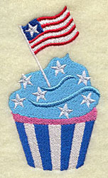 A patriotic cupcake machine embroidery design with star frosting and an American flag.