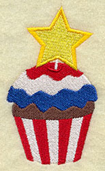 A patriotic cupcake machine embroidery design with red, white, and blue frosting and a star decoration.