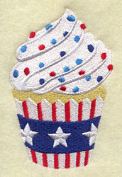 A patriotic cupcake machine embroidery design with red, white, and blue frosting and stars and stripes decoration.
