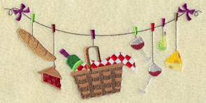 A clothesline machine embroidery design with gourmet picnic items including bread, wine, and cheese.