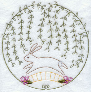 A quick stitch circle machine embroidery design with a hopping bunny.