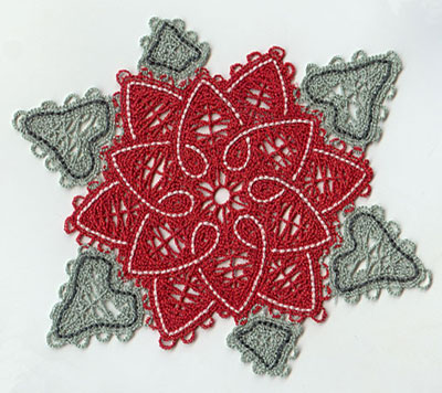 A Battenburg lace poinsettia.