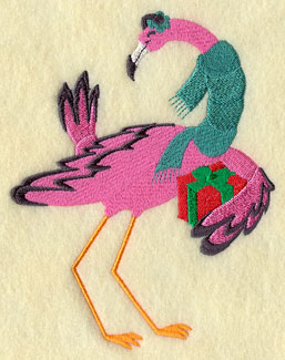 A Christmas flamingo wears a scarf and holds a present.