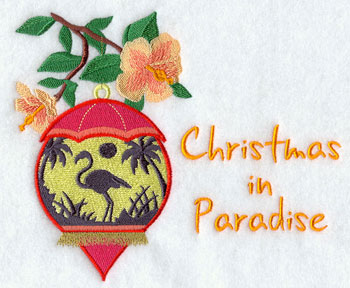 """Christmas in Paradise"" with a flamingo beach silhouette scene inside a hibiscus-decorated ornament."