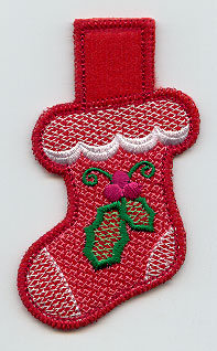 An in-the-hoop Christmas stocking clothespin cozy.