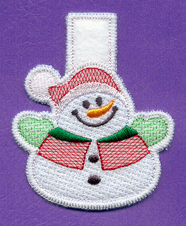 An in-the-hoop snowman clothespin cover.