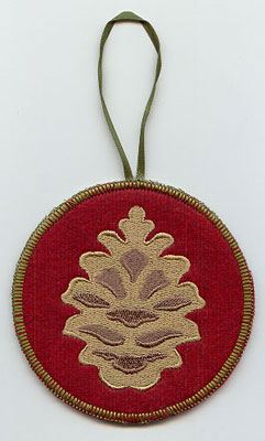 A Northwoods pine cone in-the-hoop Christmas ornament.