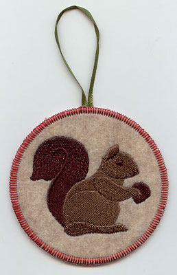 A Northwoods squirrel in-the-hoop Christmas ornament.