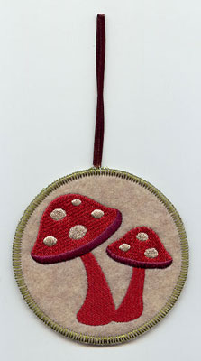 A Northwoods mushroom pair in-the-hoop Christmas ornament.