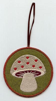 A Northwoods mushroom in-the-hoop Christmas ornament.