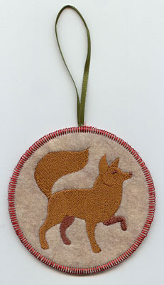 A Northwoods fox in-the-hoop Christmas ornament.
