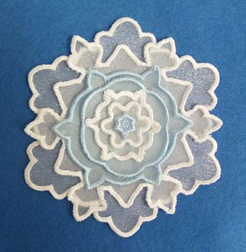 3D applique snowflake machine embroidery design.