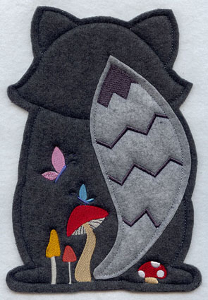 Crafty cut applique raccoon back.
