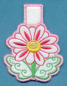 An in-the-hoop machine embroidery daisy clothespin cover.