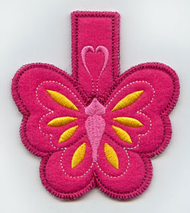 An in-the-hoop machine embroidery butterfly clothespin cozy.