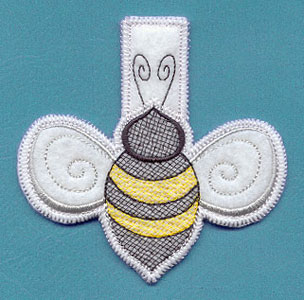 An in-the-hoop machine embroidery bumblebee clothespin cover.