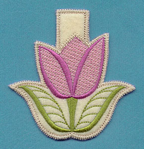 An in-the-hoop machine embroidery tulip clothespin cozy.