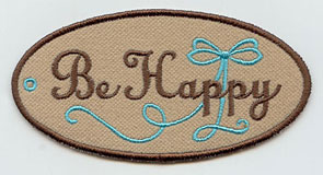 "An in-the-hoop gift tag that says ""B e Happy."""
