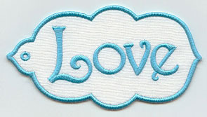 "An in-the-hoop gift tag that says ""Love."""